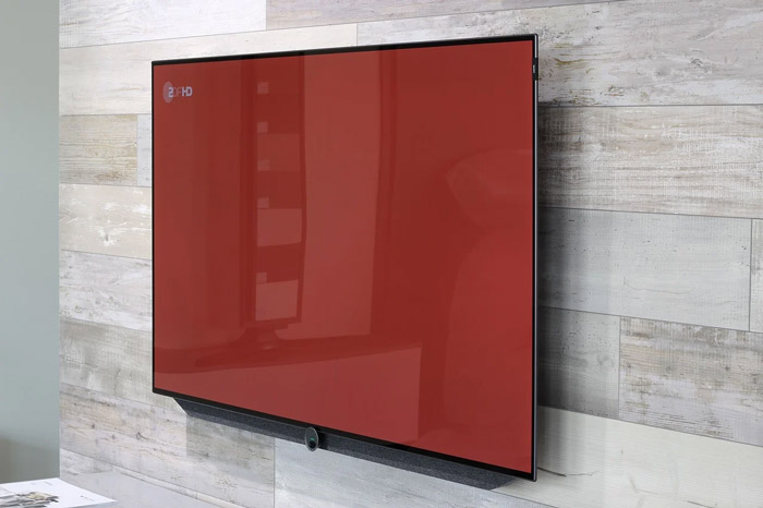 A TV is mounted on a wall